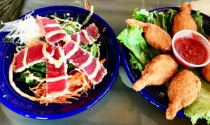 sushi grade ahi tuna over seaweed salad healthy